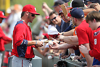 Washington Nationals right fielder Bryce Harper #34 signs autographs before a spring training game against the Houston Astros at Osceola County Stadium on March 3, 2012 in Kissimmee, Florida.  (Mike Janes/Four Seam Images)