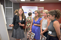 """From left, Emily Applewhite '16 talks about her research on """"Living in the Hybrid Zone: Testing the Species Squabble with two Mexican Highland Birds"""" with Emma White '16, Caitlin Lingelbach '16 and Lisa Najarian '16. After researching all summer, Occidental College students present their work at the annual Summer Undergraduate Research Conference on July 29, 2015.<br /> (Photo by Marc Campos, Occidental College Photographer)"""