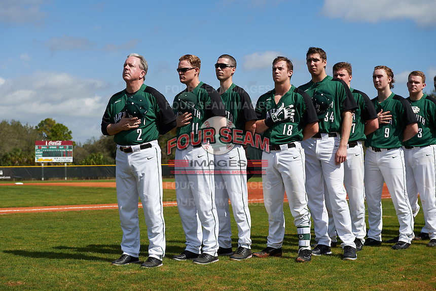 Dartmouth Big Green Bob Whalen (2), Jonathan Anderson (11), Evan Wells (7), Adam Gauthier, Michael Danielak (34), Michael Ketchmark, Kyle Holbrook (9), and Michael Calamari (3) during the national anthem before a game against the Eastern Michigan Eagles on February 25, 2017 at North Charlotte Regional Park in Port Charlotte, Florida.  Dartmouth defeated Eastern Michigan 8-4.  (Mike Janes/Four Seam Images)