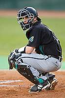 Coastal Carolina Chanticleers catcher Tyler Chadwick (32) looks to the dugout for the sign during the game against the High Point Panthers at Willard Stadium on March 15, 2014 in High Point, North Carolina.  The Panthers defeated the Chanticleers 11-8 in game two of a double-header.  (Brian Westerholt/Four Seam Images)