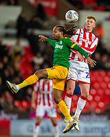 12th February 2020; Bet365 Stadium, Stoke, Staffordshire, England; English Championship Football, Stoke City versus Preston North End; Daniel Johnson of Preston North End lose the header to Sam Clucas of Stoke City
