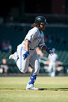 Surprise Saguaros third baseman Vladimir Guerrero Jr. (27), of the Toronto Blue Jays organization, hustles towards first base during an Arizona Fall League game against the Mesa Solar Sox at Sloan Park on November 1, 2018 in Mesa, Arizona. Surprise defeated Mesa 5-4 . (Zachary Lucy/Four Seam Images)