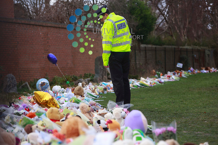 Members of the police lay flowers and candles in Ferry Gait Crescent. Mikaeel Kular who has been found death in Kircardy last Friday 17th January: Pako Mera/Universal News And Sport (Europe) 20/01/2014