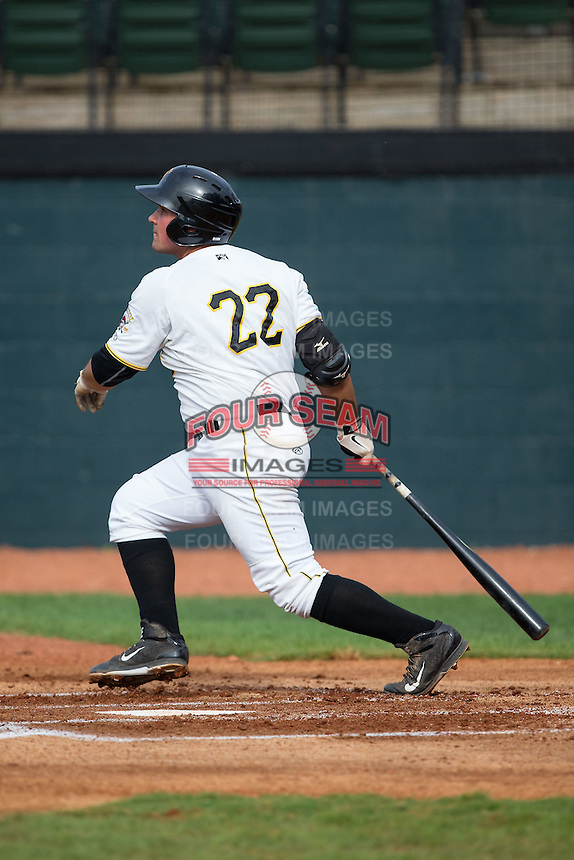 Carlos Munoz (22) of the Bristol Pirates follows through on his swing against the Johnson City Cardinals at Boyce Cox Field on July 7, 2015 in Bristol, Virginia.  The Cardinals defeated the Pirates 4-1 in game one of a double-header. (Brian Westerholt/Four Seam Images)