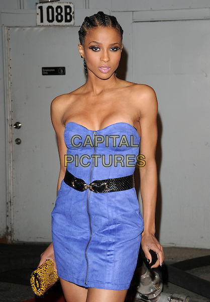 CIARA aka Ciara Princess Harris.The Maxim's Hot 100 List Party held at Barker Hangar in Santa Monica, California, USA..May 13th, 2009.half length purple strapless dress black belt hair braids plaits zip zipper cleavage gold clutch bag .CAP/DVS.©Debbie VanStory/Capital Pictures.