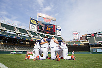 Members of the Illinois Fighting Illini kneel before the game 2015 Big Ten Conference Tournament game between the Illinois Fighting Illini and Nebraska Cornhuskers at Target Field on May 20, 2015 in Minneapolis, Minnesota. (Brace Hemmelgarn/Four Seam Images)