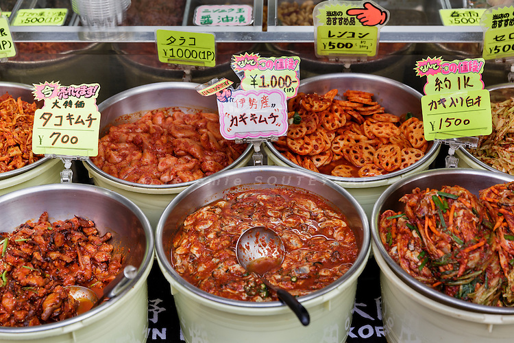 Osaka, Japan, November 25 2016 - Kimchi (traditional fermented Korean side dish made of vegetables) for sale at Osaka&rsquo;s Korea town in Tsuruhashi, the home of the largest Korean community (Zainichi) in Japan.<br /> The majority of Koreans in Japan are Zainichi Koreans, often known simply as Zainichi , who are the permanent ethnic Korean residents of Japan. The term &quot;Zainichi Korean&quot; refers only to long-term Korean residents of Japan who trace their roots to Korea under Japanese rule, distinguishing them from the later wave of Korean migrants who came mostly in the 1980s. The estimated population is about 500,000 people. As of 2016, about 90% of them have South Korean nationality and 10% of them are considered by Japanese administration as &laquo;&nbsp;Korean&nbsp;&raquo; (chosenjin), the word used for korean people before the division between North and South Korea in 1948. The ratio used to be the opposite in the 1950ies.