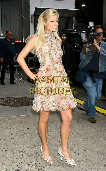 PARIS HILTON .At the David Letterman Late Show, Ed Sullivan Theatre, New York City, USA,.April 28th 2005..full length brown beige floral patterned print flower dress ruffles hand on hip.Ref: IW.www.capitalpictures.com.sales@capitalpictures.com.©Ian Wilson/Capital Pictures.