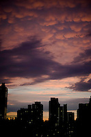 Purple cotton-ball cloudy sunset on the Upper East Side of Manhattan.
