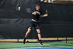 Alan Gadjiev of the Wake Forest Demon Deacons returns the ball during the match against the Florida Gators at the Wake Forest Tennis Center on March 30, 2018 in Winston-Salem, North Carolina.  The Gators defeated the Demon Deacons 4-3.  (Brian Westerholt/Sports On Film)