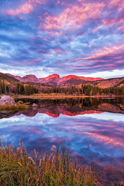 September sunrise reflection at Sprague Lake in Rocky Mountain National Park, Colorado, USA
