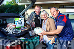 Colm Nolan, Noreen Casey and Brian O'Sullivan getting prepared for Castleisland Rugby club Carboot sale