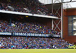 Rangers fans in the West Enclosure link arns and turn their backs to the pitch as they score goal no 4