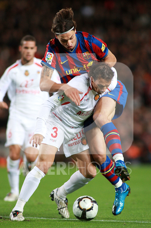 Football Season 2009-2010. Barcelona's player Zlatan Ibrahimovic and Mallorca's player Josemi during the Spanish first division soccer match at Camp Nou stadium in Barcelona November 07, 2009.