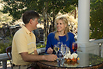 Couple dining in the fresh air at riverside on the porch of Mama Rose's restaurant in Estes Park, Colorado - a Rocky Mountain tourist destination in summer season, USA, (MR)