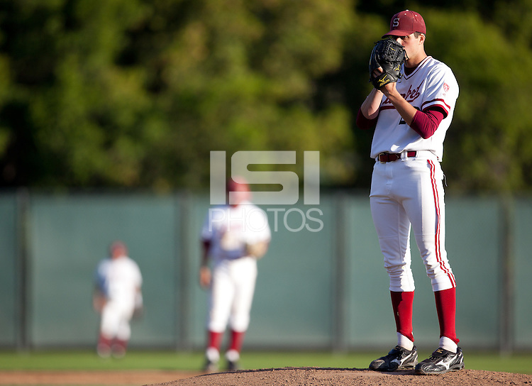 STANFORD, CA - April 15, 2011: Mark Appel of Stanford baseball looks to his catcher before pitching during Stanford's game against Oregon State at Sunken Diamond. Stanford lost 1-0.