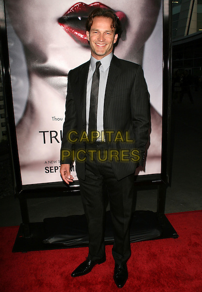STEPHEN MOYER .True Blood premiere held at the Cinerama Dome, Hollywood, California, USA, 04 September 2008..full length black suit tie .CAP/ADM/FS.©Faye Sadou/Admedia/Capital Pictures