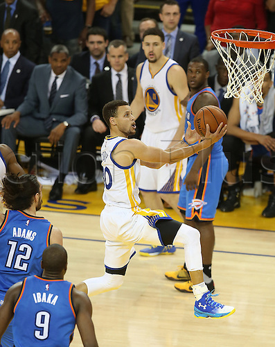 30.05.2016. Oakland, CA, USA - Golden State Warriors' Stephen Curry (30) drives to the hoop for a basket past the Oklahoma City Thunder's Steven Adams (12) and Serge Ibaka (9) during the second half on Monday, May 30, 2016, at Oracle Arena in Oakland, Calif. The Warriors won 96-88  to go through to the best of 7 finals versus Cleveland.