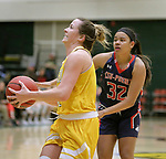 SPEARFISH, SD: DECEMBER 30:  Rachel Erickson #12 of Black Hills State drives past Tuileisu Anderson #32 of CSU Pueblo during their game Saturday evening at the Donald E. Young Center in Spearfish, S.D.   (Photo by Dick Carlson/Inertia