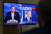 "United States President Barack Obama is seen on a television screen as he guest hosts during a taping of Comedy Central's ""The Colbert Report"" in Lisner Auditorium on the campus of George Washington University in Washington, D.C., U.S., on Monday, December 8, 2014. This is President Obama's third appearance on ""The Colbert Report"" that will broadcast its final show on December 18, 2014. <br /> Credit: Andrew Harrer / Pool via CNP"