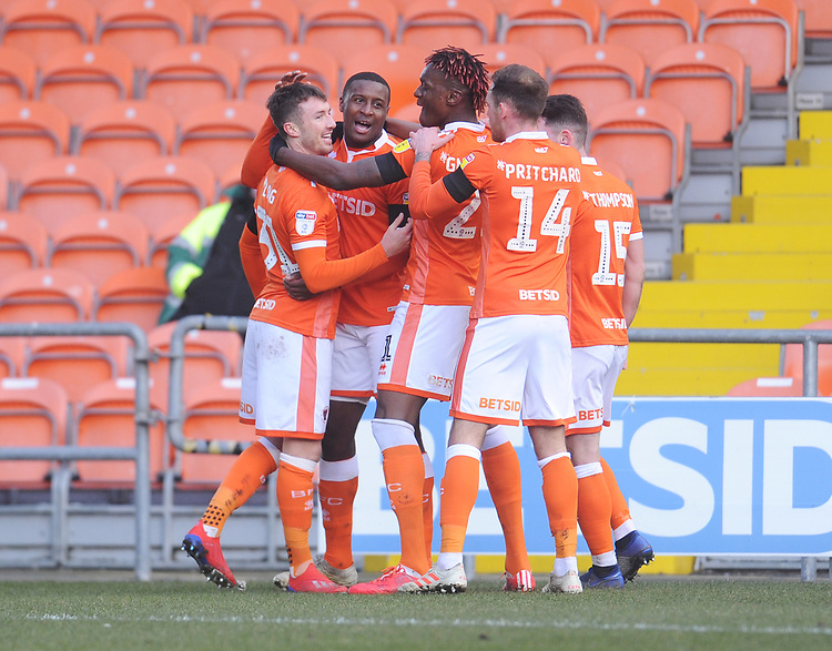 Blackpool's Chris Long (left) celebrates scoring the opening goal with team-mates<br /> <br /> Photographer Kevin Barnes/CameraSport<br /> <br /> The EFL Sky Bet League One - Blackpool v Walsall - Saturday 9th February 2019 - Bloomfield Road - Blackpool<br /> <br /> World Copyright &copy; 2019 CameraSport. All rights reserved. 43 Linden Ave. Countesthorpe. Leicester. England. LE8 5PG - Tel: +44 (0) 116 277 4147 - admin@camerasport.com - www.camerasport.com