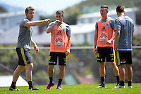 Coach Chris Greenacre talks as Kosta Barbarouses and Shane Smeltz look on. Wellington Phoenix training at Newtown Park in Wellington, New Zealand on Tuesday, 20 December 2016. Photo: Dave Lintott / lintottphoto.co.nz