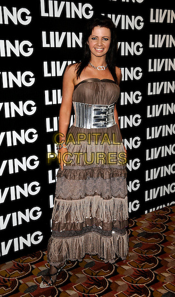 KAREN HARDY.Attending the Living TV Summer Schedule Launch event at China Tang, Park Lane, London, England, UK,. May 14th 2008.full length brown strapless dress silver waist belt buckles ruffles lace .CAP/CAN.©Can Nguyen/Capital Pictures