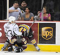 San Antonio Rampage's Wacey Rabbit, left, takes down Chicago Wolves' Jordan Schroeder during the second period of an AHL hockey game, Wednesday, April 4, 2012, in San Antonio. (Darren Abate/pressphotointl.com)