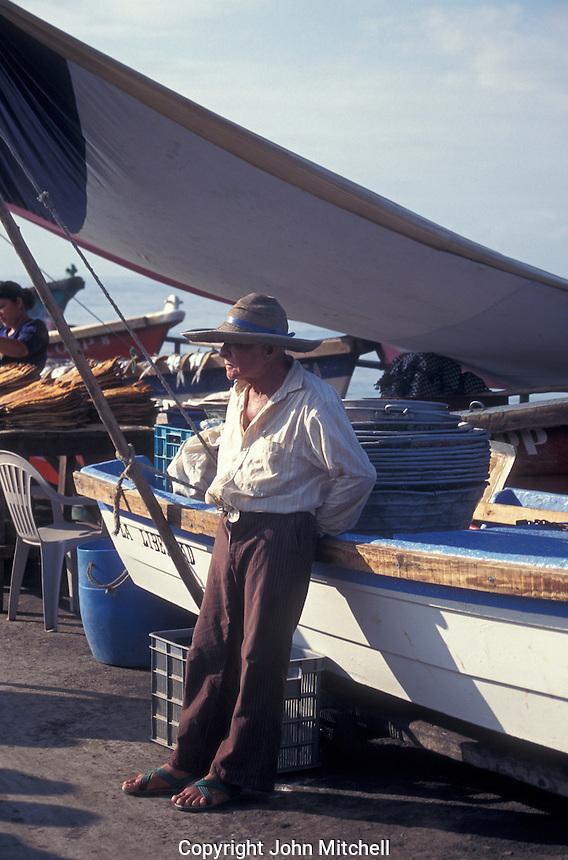 Elderly fisherman on the town pier in La Libertad, El Salvador