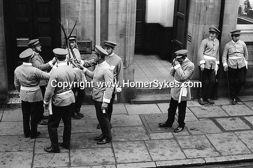 Goathland Plough Stots.  Whitby north Yorkshire. England. Sword dancers perform Whitby town center. 1972