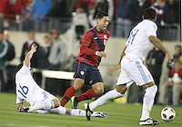 Clint Dempsey(8) of the USA MNT avoids a tackle from Marcos Riveros(16) of Paraguay during an international friendly match at LP Field, in Nashville, TN. on March 29, 2011.Paraguay won 1-0.