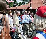 MAY 30, 2011 - LITTLE NECK, NY: Mayor Bloomberg, holding up American Flag, and New York City Council Speaker Christine C. Quinn, to his left, marching in Little Neck Douglaston Memorial Day Parade on May 30, 2011.