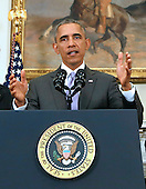 United States President Barack Obama (C) delivers a statement on the legislation he sent to Congress to authorize the use of military force (AUMF) against ISIL in the Roosevelt Room of the White House, in Washington, DC on February 11, 2015. <br /> Credit: Aude Guerrucci / Pool via CNP
