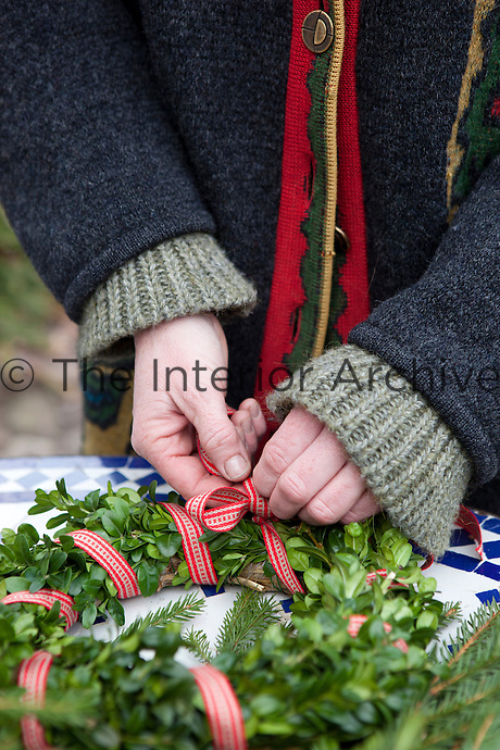 Making a festive wreath from plants freshly cut from the garden