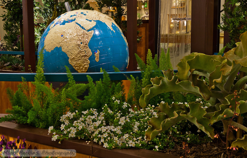 """A view of the braille world globe in context in Orange Coast College's Ornamental Horticulture Club's first-place winning garden installation at the 2012 South Coast Plaza Spring Garden Show in Costa Mesa, CA.  The theme for the show was """"healing gardens"""", and the OCC team installed a """"garden for the visually impaired.""""  The garden's centerpiece is a 1957 restored globe for the blind, with the world geography in exaggerated height to be sensed by the touch of blind people; the locations of plants in the garden was indicated in braille on the globe."""