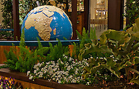 "A view of the braille world globe in context in Orange Coast College's Ornamental Horticulture Club's first-place winning garden installation at the 2012 South Coast Plaza Spring Garden Show in Costa Mesa, CA.  The theme for the show was ""healing gardens"", and the OCC team installed a ""garden for the visually impaired.""  The garden's centerpiece is a 1957 restored globe for the blind, with the world geography in exaggerated height to be sensed by the touch of blind people; the locations of plants in the garden was indicated in braille on the globe."