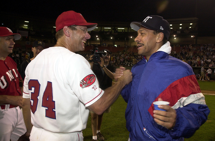 36baseball062101 -- Steve Largent, R-OK., and Melvin Watt, D-N.C., congratulate each other after the 40th Annual Roll Call Congressional Baseball Game.