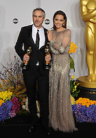 Alfonso Cuaron &amp; Angelina Jolie at the 86th Annual Academy Awards at the Dolby Theatre, Hollywood.<br /> March 2, 2014  Los Angeles, CA<br /> Picture: Paul Smith / Featureflash