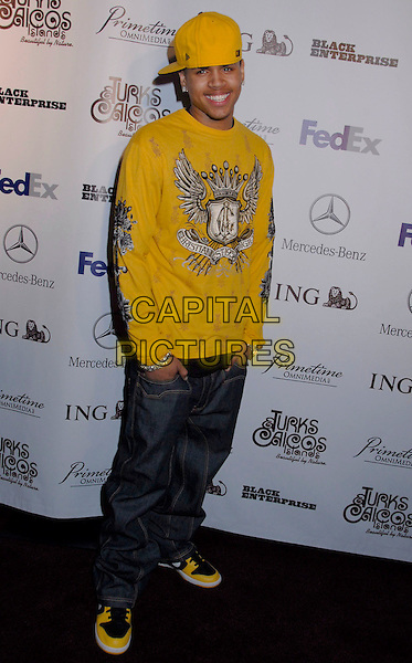 CHRIS BROWN.Black Enterprise Top 50 Hollywood Power Brokers List Party held at the Beverly Wilshire Four Seasons, Beverly Hills, California, USA, 21 February 2007..full length yellow cap hat top t-shirt trainers.CAP/ADM/GB.©Gary Boas/AdMedia/Capital Pictures.