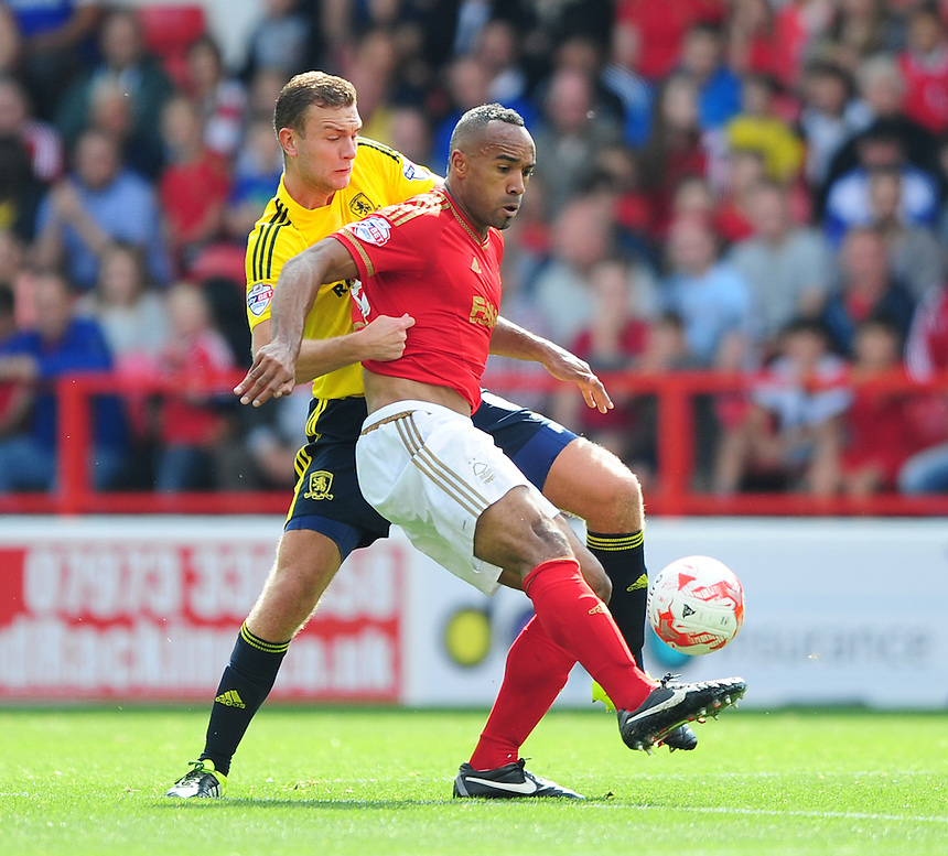 Nottingham Forest&rsquo;s Chris O'Grady shields the ball from Middlesbrough's Ben Gibson<br /> <br /> Photographer Chris Vaughan/CameraSport<br /> <br /> Football - The Football League Sky Bet Championship - Nottingham Forest v Middlesbrough - Saturday 19th September 2015 - City Ground - Nottingham<br /> <br /> &copy; CameraSport - 43 Linden Ave. Countesthorpe. Leicester. England. LE8 5PG - Tel: +44 (0) 116 277 4147 - admin@camerasport.com - www.camerasport.com