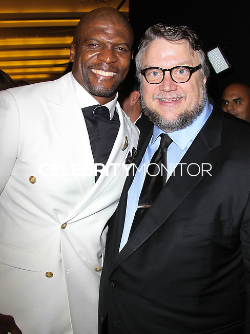 PASADENA, CA, USA - OCTOBER 10: Terry Crews, Guillermo del Toro pose in the press room at the 2014 NCLR ALMA Awards held at the Pasadena Civic Auditorium on October 10, 2014 in Pasadena, California, United States. (Photo by Celebrity Monitor)