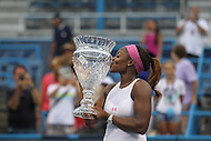 Washington, DC - August 9, 2015: After winning the Citi Open women's singles final, Sloane Stephens (USA) kisses the trophy on the court of the Fotxgerald tennis stadium at Rock Creek Park Tennis Center in Washington, DC,  August 9, 2015.  (Photo by Elliott Brown/Media Images International)