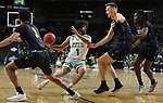 SIOUX FALLS, SD - MARCH 8: Marlon Stewart #1 of the North Dakota Fighting Hawks looks for a way to escape a triple team from the PFW Mastodons at the 2020 Summit League Basketball Championship in Sioux Falls, SD. (Photo by Dave Eggen/Inertia)