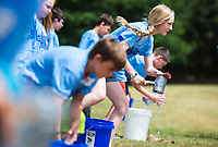 NWA Democrat-Gazette/CHARLIE KAIJO Students transport water in an engineering challenge where they work together to transport water with a group-made water transport device during a STEM camp, Monday, June 11, 2018 at Bonnie Grimes Elementary School in Rogers.<br />