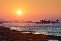 The sun rises over Brighton Pier a freezing cold but clear morning  in East Sussex, England UK. Saturday 24 February 2018