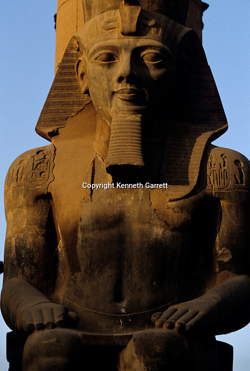 Colossal statue of Ramses II (the Great) , in front of pylon, Temple of Luxor, Thebes, Egypt, Festival of Opet