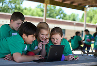 NWA Democrat-Gazette/CHARLIE KAIJO Auron Garrett, Ransom Ha, Elise Ledford and Sarah Fenix watch a video commercial they made for a STEM summer camp project, Monday, June 10, 2019 at Bonnie Grimes Elementary School in Rogers. Students used video to apply knowledge they learned about kinetic and potential energy. They created advertisements for water balloons. <br />