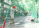 10 June 2006: Soccer fans and locals enjoy market day in Frankfurt before the game. A baseball batting cage is set up on Konstablerwache. England played Paraguay at Commerzbank Arena in Frankfurt, Germany in match 3, a Group B first round game, of the 2006 FIFA World Cup.