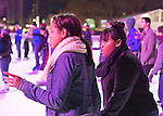 Manhattan, New York, U.S. 9th November 2013. Visitors ice skate and shop at the annual Holiday Shops, at Winter Village skating rink at Bryant Park at night.