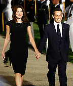 Pittsburgh, PA - September 24, 2009 -- French President Nicolas Sarkozy (R) arrives with his wife Carla Bruni Sarkozy to the welcoming dinner for G-20 leaders at the Phipps Conservatory on Thursday, September 24, 2009 in Pittsburgh, Pennsylvania. Heads of state from the world's leading economic powers arrived today for the two-day G-20 summit held at the David L. Lawrence Convention Center aimed at promoting economic growth.  .Credit: Win McNamee / Pool via CNP